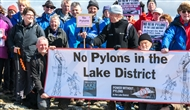 Standing tall: protesters climb Lake District hill as anti-pylon movement grows